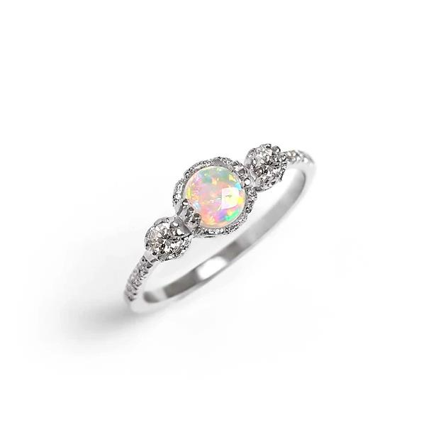 """Destiny Opal Engagement Ring, AUD price on request at [James And Irisa](https://fave.co/37BiSi2