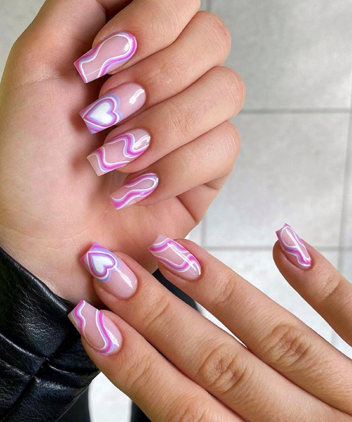 """Your bubble hearts don't have to hit both borders, either—just draw until they meet the sides and leave the bases bare. <br></br> *Image via: [@nailsfactorypl](https://www.instagram.com/nailsfactorypl/ target=""""_blank"""" rel=""""nofollow"""")*"""