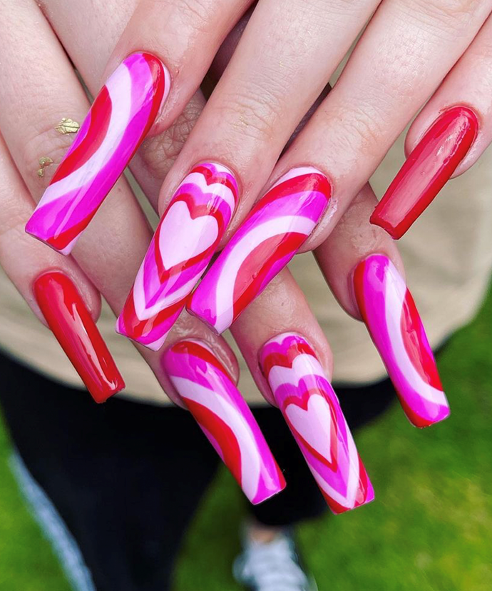 """We see nothing wrong with pulling out one of your heart shades and giving it a solo moment on a nail or two. <br></br> *Image via: [@nailsbyrachel.x](https://www.instagram.com/nailsbyrachel.x/ target=""""_blank"""" rel=""""nofollow"""")*"""