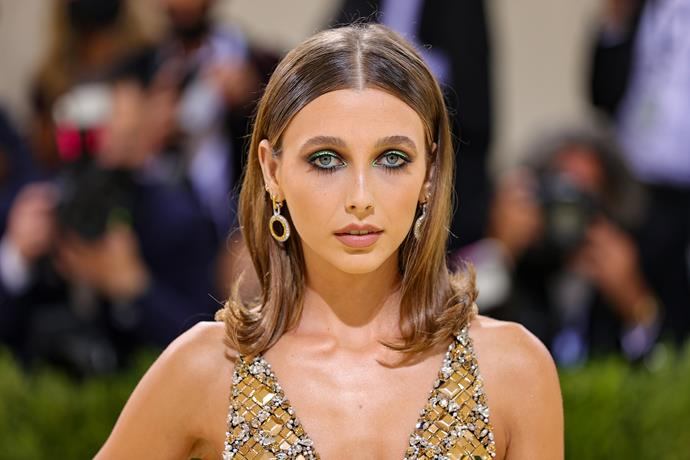 Emma Chamberlain was an absolute vision on the carpet, serving retro 70s energy, executed flawlessly. Her hairstylist Laura Polko opted for flipped ends to add a healthy dose of bounce, while makeup artist Kelsey Deenihan chose a classic smoky eye with bright green accents. It was the perfect eye look to offset her stunning bedazzled mini dress.