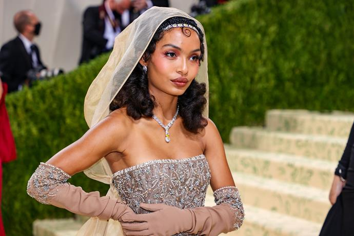 Yara Shahidi drew inspiration from Josephine Baker for her look, opting for a braided hair crown and soft, mauve makeup.