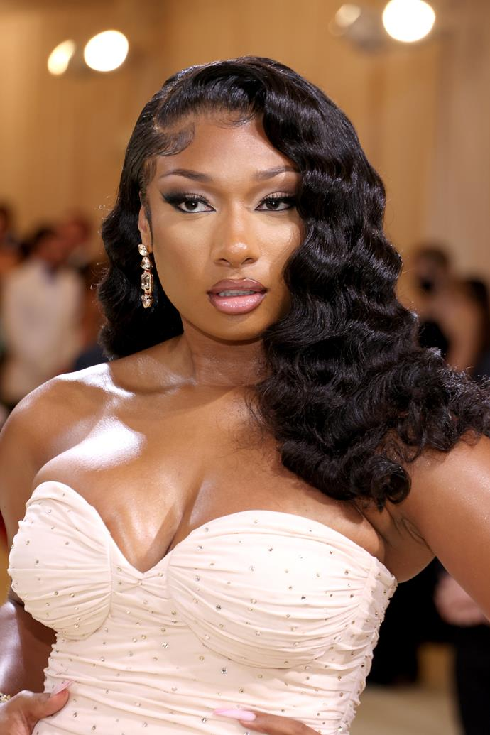 Megan Thee Stallion appeared in a very different look, showcasing her softer, feminine side. Her tresses fell down around her shoulders in soft yet dramatic waves, and her ombre makeup look was the perfect compliment to her gown.