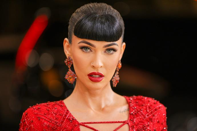 There is no denying that this look from Megan Fox is straight fire. An absolute vision in red, the bold lipstick choice was an absolute must. The actress was also sporting blunt cut bangs, which accentuated her green eyes and dark makeup features even further.