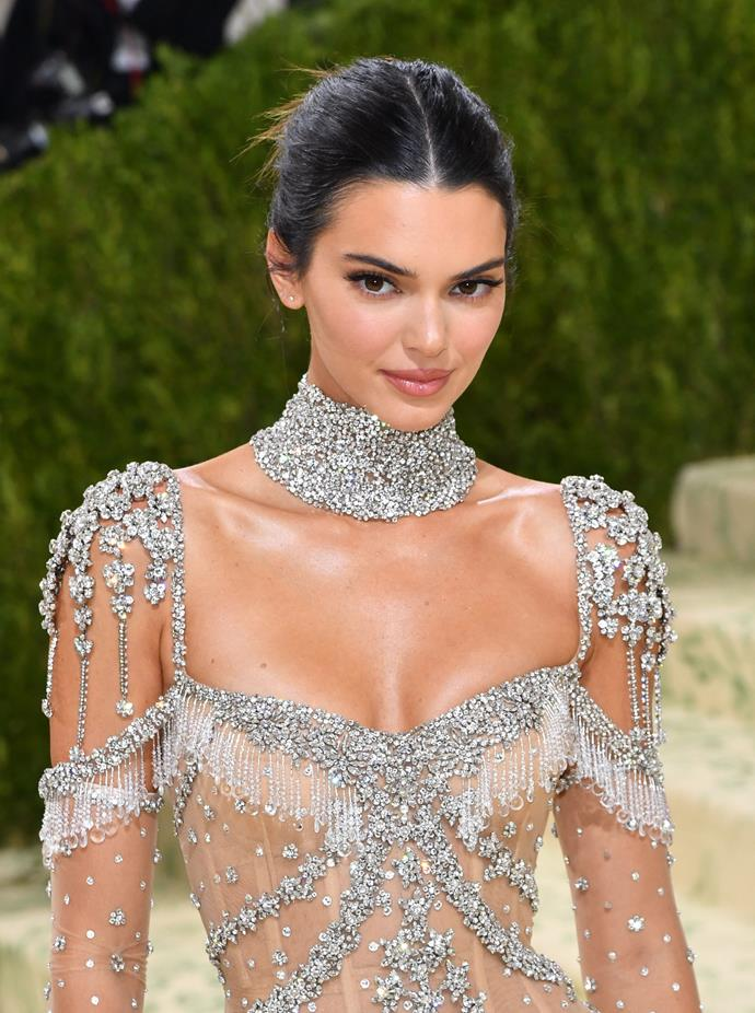 A bedazzled dress like this calls for an understated hair and makeup look, which is exactly what supermodel Kendall Jenner delivered. A relaxed up-do and nude lip are the perfect compliment to this dramatic ensemble.