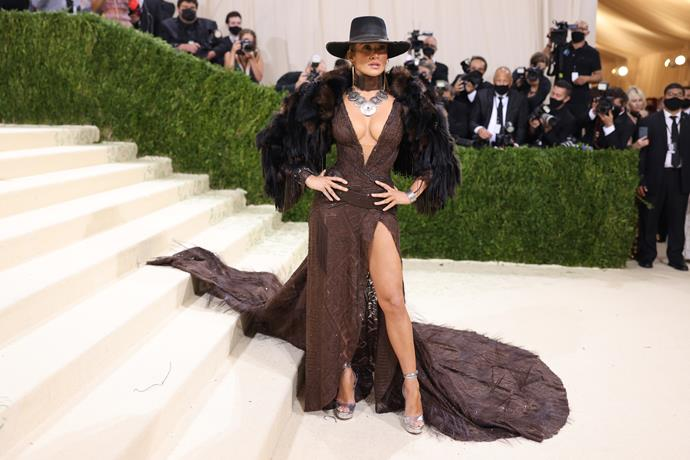 While we can't necessarily see JLo's hair and makeup, we have no doubt that it's flawless. Her accessories are the ones doing all the talking to tie this look together, with her dramatic necklace and wide-brimmed hat making a serious impact.