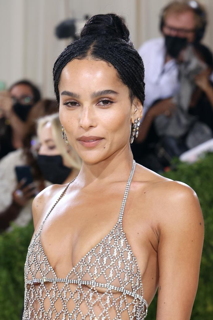 Zoe Kravitz can do no wrong and her entrance at the 2021 Met Gala is further proof of this notion. Her understated makeup look is a testament to her natural beauty, with drop earrings and a sophisticated up-do hairstyle tying everything together.