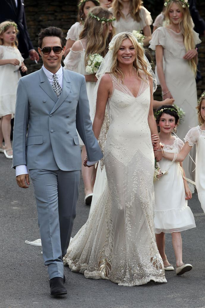 """**Kate Moss in John Galliano (2011)**<br><br> Supermodel Kate Moss married Jamie Hince in a gorgeous custom-made gown by John Galliano. The dress was later exhibited in the Victoria & Albert museum in 2014 as part of its exhibition of wedding dresses. Speaking of the gown, Kate later said she had wanted """"a classic Galliano, those chiffon '30s kind. I've lived in his dresses for years, and they just make me feel so comfortable. But it's so much more couture, couture, couture."""