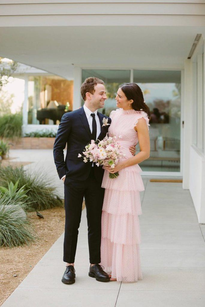 **Mandy Moore in Rodarte (2018)**<br><br> Actress Mandy Moore was an absolute vision in pink on her wedding day, marrying musician Taylor Goldsmith in an intimate backyard ceremony. While the dress was non-traditional, it was certainly stunning, with ruched detailing adding a dramatic yet delicate flair. The bride finished the look with a pink tulle veil with floral embroidery and glittery pink eyeshadow. Divine!