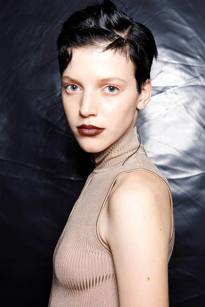 **Peach Pigments** <br><br> Typically, a peach pigment is applied to the inner waterline to widen the eyes and emulate a more awake look, after a potentially big night. But when it came to Drome's spring/summer 2022 show, makeup artist, Karin Borromeo, opted for the pastel shade on the waterline *and* around the lid for a pale effect. Paired with a burgundy lip, the rest of the look is kept simple with a bare brow and a natural complexion. <br><br> *Image: Drome spring/summer 2022.*
