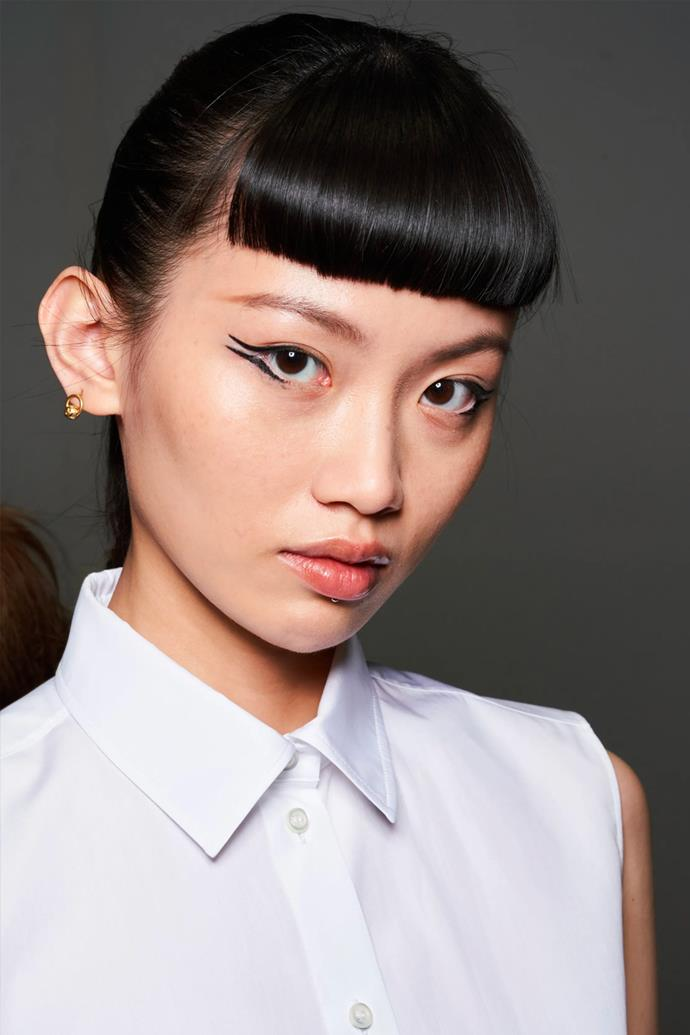 **Liner Lust** <br><br> Echoed through shows in both London and Milan, graphic and brightly coloured eyeliner reigned supreme once more amongst the fashion set. Dior opted for a set of razor-sharp double wings, meeting at the temple from the upper and lower lash lines, sitting neatly beneath an equally sharp blunt fringe. Whereas at Chloé, neon hues showcased simple, yet expertly executed, winged liner that has us reaching for every glow-in-the-dark hue in sight. <br><br> *Image: Dior spring/summer 2022.*
