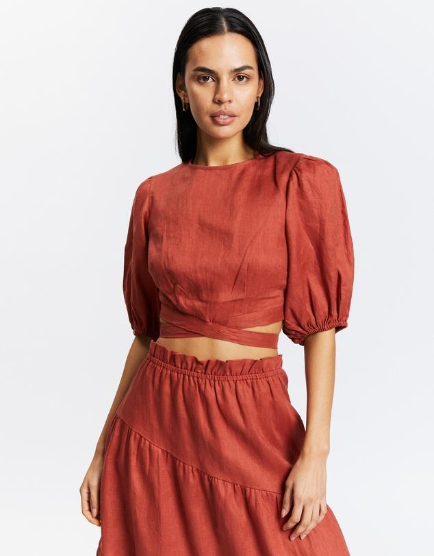 """Cross Back Linen Top, $130; at [THE ICONIC](https://www.theiconic.com.au/cross-back-linen-top-1327048.html