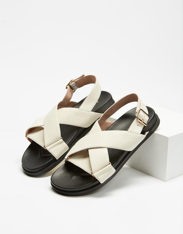 """Crossover Leather Footbed Sandals, $130; at [THE ICONIC](https://www.theiconic.com.au/crossover-leather-footbed-sandals-1161355.html