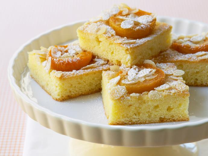 """Wonderfully fluffy and moist, this [apricot slice](https://www.womensweeklyfood.com.au/recipes/apricot-slice-27954