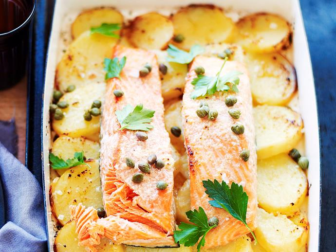 "**[Lemon and garlic roast salmon on potatoes](https://www.womensweeklyfood.com.au/recipes/lemon-and-garlic-roast-salmon-on-potatoes-25516|target=""_blank"")**"