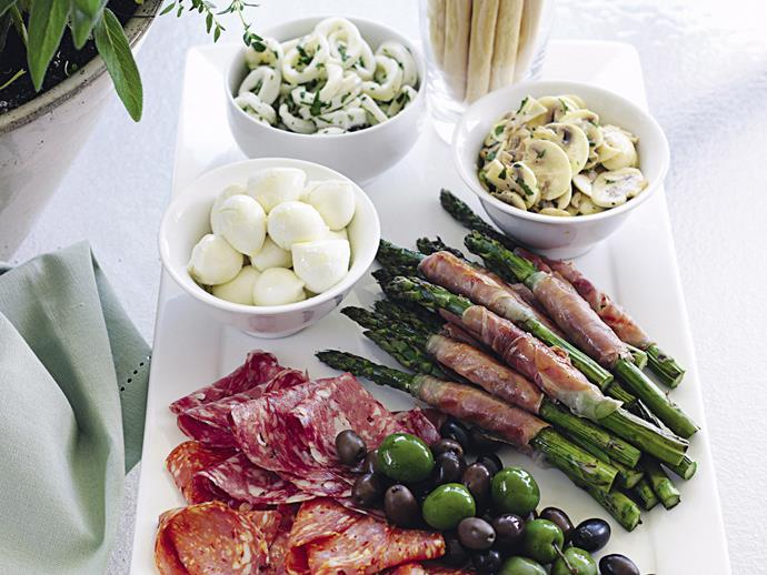 This [antipasto plate](http://www.foodtolove.com.au/recipes/antipasto-plate-4185) is perfectly for nibbling.