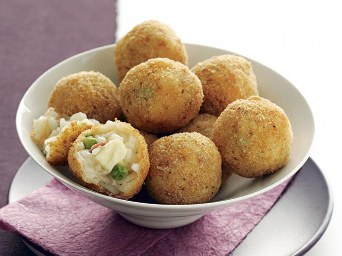 """[Arancini](https://www.womensweeklyfood.com.au/recipes/arancini-recipe-27528
