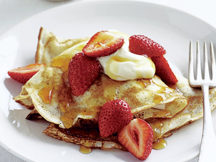 Crepes with maple syrup, strawberries, and cream