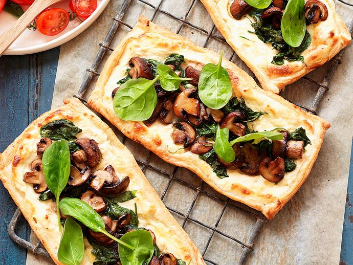 """**[Mushroom and spinach tarts with tomato salad](https://www.womensweeklyfood.com.au/recipes/mushroom-and-spinach-tarts-with-tomato-salad-23914