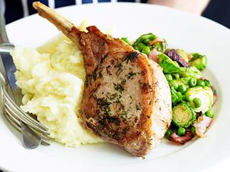 pork cutlets with bacon, brussels sprouts and peas