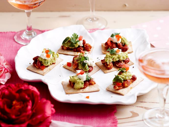 "**[Nacho bites](https://www.womensweeklyfood.com.au/recipes/nachos-bites-25447|target=""_blank"")**  Add some Mexican flair to your appetisers with these bite-sized morsels of nacho goodness."