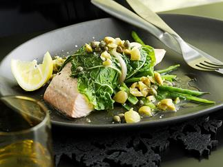 steamed salmon in silverbeet with lemon and olive sauce