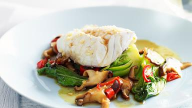 Steamed fish with bok choy and mushrooms