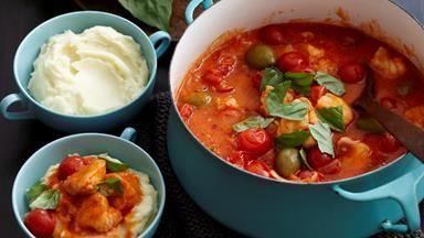 Fish, tomato and olive stew on creamy mash