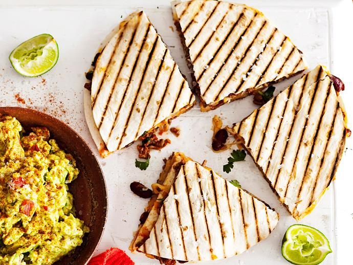 "**[Mexican beef and bean quesadilla](https://www.womensweeklyfood.com.au/recipes/beef-and-bean-quesadilla-stacks-7526|target=""_blank"")** stacks with a zesty guacamole"