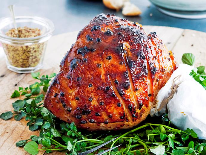 "**Maple, mustard and orange glazed ham** <br><br> This ham looks impressive, but the glaze is actually super easy to make.  <br><br> [**Read the full recipe here**](https://www.womensweeklyfood.com.au/recipes/maple-mustard-and-orange-glazed-ham-22433|target=""_blank"")"