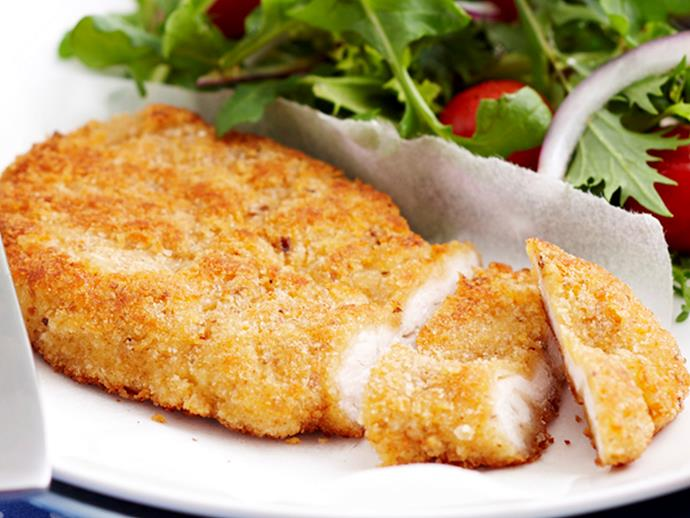 **The 1970s: [Schnitzel with mashed potatoes and lemon.](https://www.womensweeklyfood.com.au/recipes/chicken-schnitzel-27759)** Anything crumbed was very trendy in the '70s. Things like schnitzel and kiev became a key dish on many Aussie dinner tables.