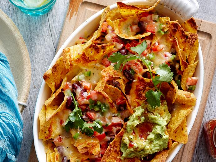 "**[Quick grilled nachos](https://www.womensweeklyfood.com.au/recipes/quick-grilled-nachos-27271|target=""_blank"")**  Whip up this Mexican favourite in no time at all. Your family and friends will love sharing this big tray of vegetarian nachos, enjoying the oozy melted cheese, spicy tomato salsa and creamy avocado atop crunchy corn chips."