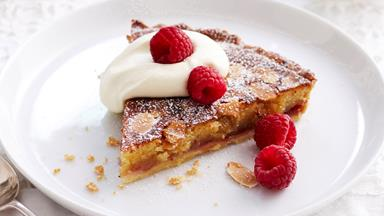 Bakewell tart with whipped cream and berries