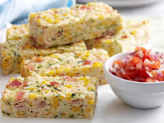 """Light, cheesy and packed full of flavour, this tasty [corn, bacon and zucchini rice slice](https://www.womensweeklyfood.com.au/recipes/corn-bacon-and-zucchini-rice-slice-26019