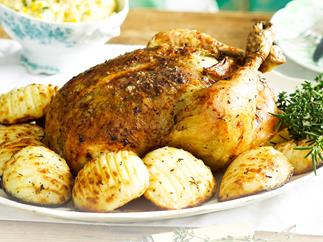 Roast lemon and herb chicken with hasselback spuds