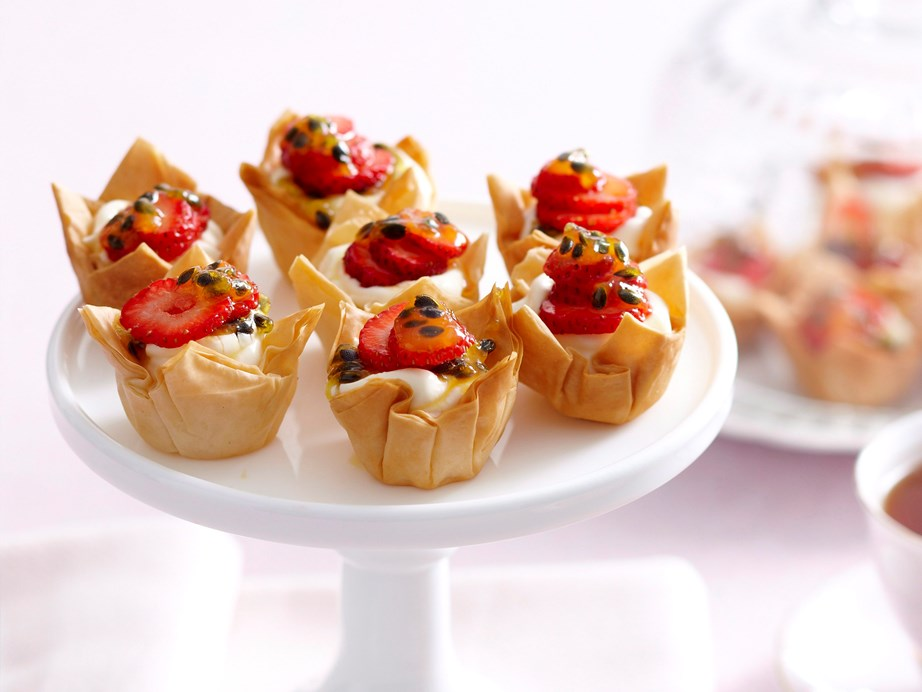 "**[Mini cream cheese tarts](https://www.womensweeklyfood.com.au/recipes/mini-cream-cheese-tarts-27503|target=""_blank"")** <br><br> A golden, flaky crust surrounds the divine cream cheese filling in these sweet mini tarts. Topped with fresh strawberries and passionfruit, they are perfect for a quick dessert or light finger food when entertaining guests."