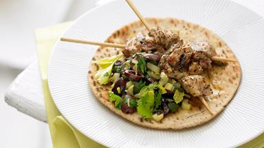 Chicken kebabs with celery and olive salad