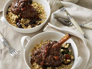 Lamb shanks with sumac, mint and date stuffing and couscous with eggplant