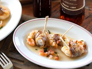 Pancetta prawns with sambuca salsa