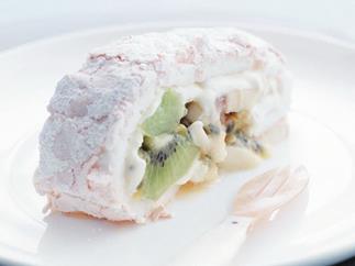 pavlova roll with banana, kiwi and passionfruit