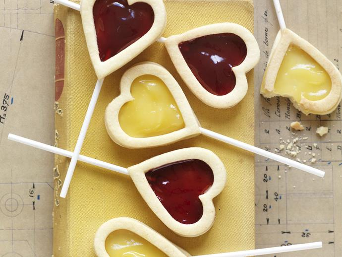 """Baked on lollipop sticks, these [raspberry and lemon curd heart biscuits](https://www.womensweeklyfood.com.au/recipes/raspberry-and-lemon-curd-heart-biscuits-13746