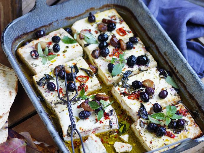 """**[Baked feta with roasted garlic, chilli and olives](https://www.womensweeklyfood.com.au/recipes/baked-feta-with-roasted-garlic-chilli-and-olives-13970