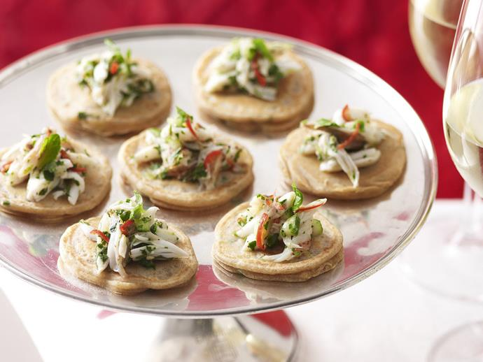 "**[Green onion blinis with chilli crab salad](https://www.womensweeklyfood.com.au/recipes/green-onion-blinis-with-chilli-crab-salad-13553|target=""_blank"")**"