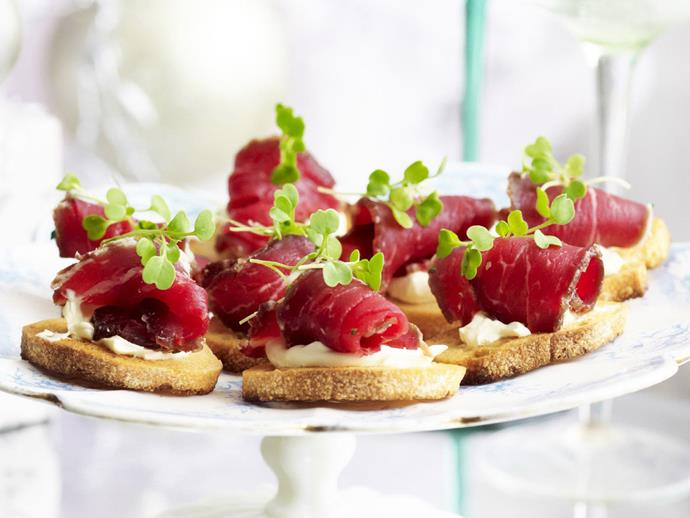 "**Salt, lemon and rosemary-cured beef** <br><br> Make your own rosemary and lemon cured beef to sit atop crisp sourdough toasts with sour cream - perfect for a canape or starter at your next dinner party. <br><br> [**Read the full recipe here**](https://www.womensweeklyfood.com.au/recipes/salt-lemon-and-rosemary-cured-beef-4465|target=""_blank"")"
