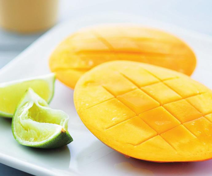 MANGO CHEEKS WITH LIME WEDGES
