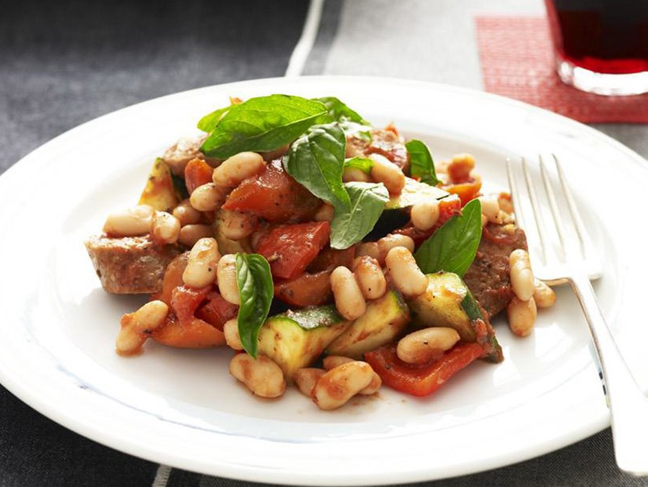 "This recipe for [oven-baked lamb sausages, beans & tomatoes](https://www.womensweeklyfood.com.au/recipes/oven-baked-lamb-sausages-beans-and-tomatoes-9824|target=""_blank"") is a deliciously hands-off recipe. Once you throw this tasty casserole into the oven you can finally get on with other things!"