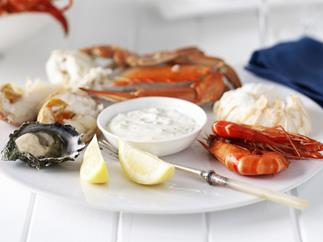 cold seafood platter with dipping sauces