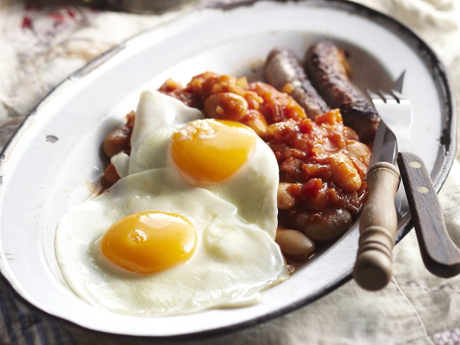 """Home made [baked beans, with bacon, sausages and eggs](https://www.womensweeklyfood.com.au/recipes/breakfast-beans-with-bacon-sausages-and-eggs-15242