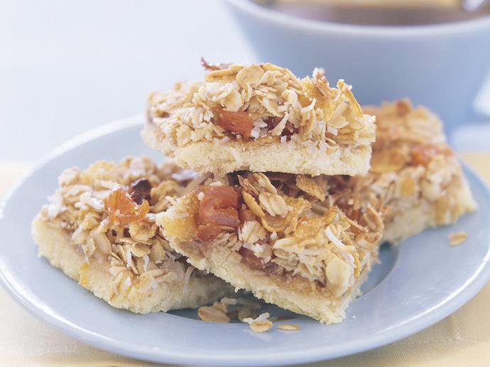 "**[Apricot muesli slice](https://www.womensweeklyfood.com.au/recipes/apricot-muesli-slice-13389|target=""_blank"")**  With a crunchy oat, cornflake and coconut topping, this slice is the perfect morning pick-me-up."