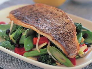 crisp-skinned snapper with stir-fried vegetables and black beans