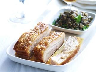 crisp-skinned pork belly with braised green lentils